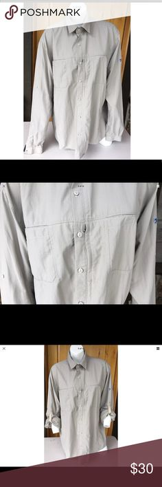 Kuhl l/s grey shirt nylon/poly excellent cond Excellent condition nylon/ poly material-lightweight. L/S grey. Check the pictures with the measurements and compare to one of your shirts. Tag states 2xl it is closer to a big xl. No stains or rips. Smoke free home if that is important.  Check the measurements. Kuhl Shirts Casual Button Down Shirts