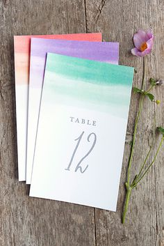 Add some flair with these color washed table numbers printable in different colors @intimatewedding #colorwash #tablenumbers #freeprintables