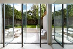 British Duo Todhunter Earle Pairs Psychology and Design - Introspective Arched Windows, Windows And Doors, Outdoor Spaces, Outdoor Living, Minimalist Garden, Outdoor Furniture Design, London House, Spacious Living Room, Decoration