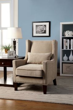 Tomar collection contemporary style high back accent wing chair with ivory fabric upholstery and nail head trim