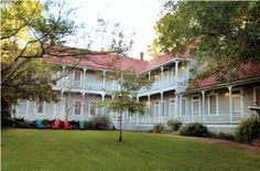 Find this beautiful 1901 #Texas Historic Landmark, a 3-Diamond Railroad Resort, on #LakeLBJ. Six antique appointed suites plus 6 Cabins and 4 Train Cabooses with kitchenettes total 26 bedrooms and private baths with double occupancy at 48 to 60 people.  #KSIR #RealEstate #Luxury