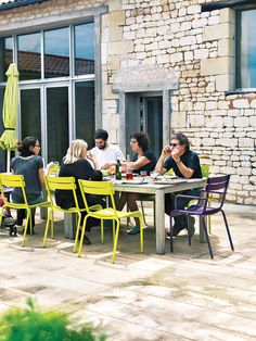 For a stone farmhouse in Paris, cerebral architect Matali Crasset paired a custom-made table with Fermob's Luxembourg chairs for alfresco meals on the patio. Photo by Jonas Ingerstedt.  Photo by Jonas Ingerstedt.   This originally appeared in Matali Crasset Renovates Monory Farmhouse.
