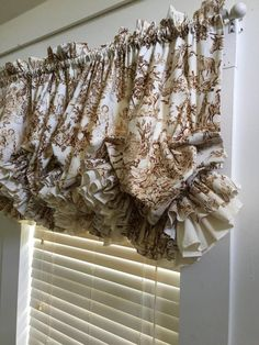 This listing is made of Riley Blake Fable Brown toile. It has one ruffle of the toile and one of unbleached muslin. It will fit a window of up to 49 inches wide. There are rings and clips on the back to adjust the length. I have pillow shams to match here: