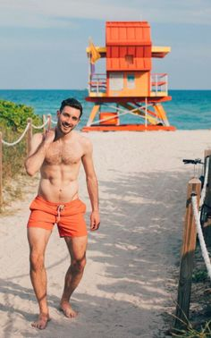 Matching my orange swimwear to lifeguard huts! Does this give you summer mens beachwear inspiration, I love south beach with all the unique coloured lifegaurd towers!