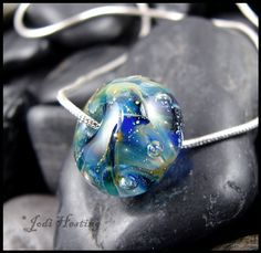 One of my handmade lampwork glass beads. If you love my creations please check my website out at www.beadworx.com