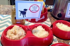 Creative hot dog bar and food choices.  Love using the dog bowls as serving bowls.  So cute!