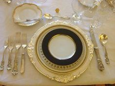2013 Presidents' Day Dinner. Silver charger, white and gold greek key dinner plates, Fitz and Floyd salad plates, Francis I flatware.