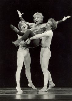 "Ballet superstars MIKHAIL BARYSHNIKOV and RUDOLF NUREYEV give a ""lift"" to musical comedy star GWEN VERDON"