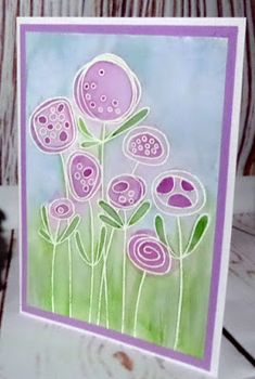 "Woodware ""Tall Flowers"" stamp as a faux bleached background coloured with Distress Inks."