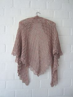 This is a topdown triangle shawl with a repetitive lace pattern. The lacy border is worked sideways.