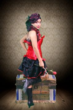 This design was custom made for the Clay Walker Jesse James video, and worn by New Orleans Saintsation, Lauren!  Black with red fluer de lis and trimmed in red, tie it on over a skirt, leggings, or shorts. Looks fantastic with a red corset! Order yours in your choice of colors and size. Find it at yes2years.com