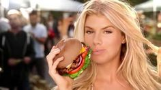 """Conflation of """"all-natural"""" food with going """"all-natural."""" Uses female body as stand-in for the meat. And desire for the burger and the woman are conflated. (Thanks Laurel W.!)"""