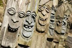 wood carved laughing