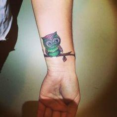 12 - tattoo owl on the wrist