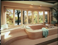 Relax and soak in the natural light with Pella® Designer Series® ENERGY STAR® -qualified wood bow windows.