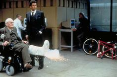 Head of Q-Division (Desmond Llewelyn) instructing James Bond (Pierce Brosnan) in GoldenEye Pierce Brosnan, James Bond Gadgets, Habits Of Mind, Licence To Kill, James Bond Movies, Kingsman, Album
