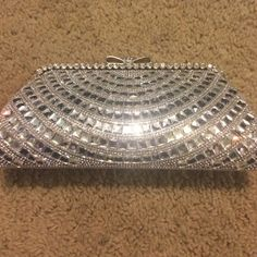 Silver bling evening bag with chain Carried for a few minutes on my wedding day. Measures 9 inches across and 5 inches tall. Has a removable chain. Does have two small spots inside from something possibly lip gloss. Bags Clutches & Wristlets