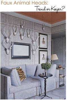 Faux Animal Heads on nail headed wallpaper