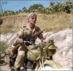 Despatch rider Private Harry McDowell of the 48th Highlanders of Canada, 1st Canadian Infantry Brigade, delivering a message to the battalion's advanced headquarters. Regalbuto, Italy, August 4, 1943.  (That looks like a Norton 16H motorbike)  Regalbuto was severely damaged during World War II, and on August 3, 1943 the German Hermann Göring Panzer Division was driven out of the town by 1st Canadian Infantry Division.