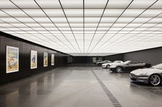 Architecture firm Molecule used The Dark Knight as inspiration in adding a basement garage to a 1929 house. The old house's modern garage is Garage House, Dream Garage, Car Garage, Garage Parking, Garage Walls, Garage Flooring, Parking Lot, Mansion Homes, Garage Boden