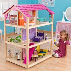 The Kidkraft So Chic Dollhouse is made of wood with 3 levels of open space, 10 rooms and 45 pieces of furniture. The Kidkraft So Chic Dollhouse accommodates all fashion dolls up to 12 inches tall including Barbie and Bratz. Barbie Furniture, Dollhouse Furniture, Kids Furniture, Furniture Decor, Wooden Dollhouse, Dollhouse Design, Dollhouse Toys, Dollhouse Ideas, Wooden Dolls