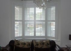 Window shutters for my living room Bay Window Shutters, White Shutters, Cafe Shutters, Corner Window Treatments, Window Coverings, House Blinds, Blinds For Windows, Bay Windows, Vertical Blinds Cover