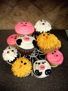 Farm animal cupcakes - I love the swirly pig and the fluffy chick the best :) too ghetto, @Lacey Billings?