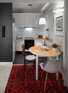 small kitchen white cabinets wooden countertop matching table and white chairs