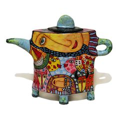 Сeramic teapot with ornament, teapot with decor, ceramic ware, coffee pot, cafetiere, teapot a decorated, ceramic teapot, teapot. Excellent fit into any decor! Perfect for a gift or for collections. Work is executed in the technique of Majolica.  ♥ Year established: 2016 ♥ Technique: Majolica ♥ Size: 16x7x20 cm (6,3x2,8x7,9) ♥ Category: utensils ceramics ♥ Style: Naive Art  This work is available or made under the order of 5-10 days. There are different sizes. The price depends on the size…