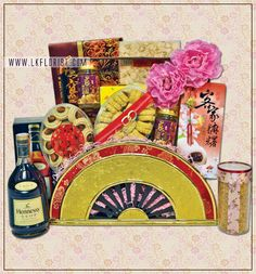 BCNY8498  RM498  *Henessy VSOP 70cl *American Ginseng Slice *Bird's Nest with Ginseng, White Fungus and Rock Sugar 6 x 70ml *Chicken Floss 150gm *Homemade Pineapple Roll 320gm *Homemade Peanut Cookies *Sesame Cake *Chicken Biscuit *Wood Half-Moon CNY Basket (BF-HM48) *CNY Decoration *Greeting Card *Delivery with PJ, KL & Outstation (cut-off date for Outstation Order is 21st Jan 2013)