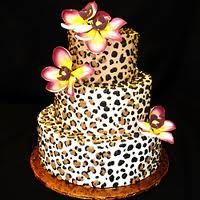 cheetah print cake. I think it would be cuter without the flowers. Or maybe just one large one.