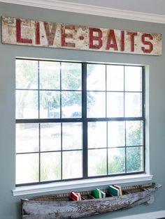 Live Bait Sign Over Window and Antique Canoe