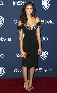 The Vampires Diaries actress wore a sexy Giorgio Armani black silk dress featuring a sweetheart neckline and off-the-shoulder straps. Ornate crystal embellishments added oomph to her party look.