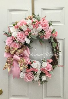This beautiful Rose Wreath is like a bouquet of pink and white roses for your door, or over your mantle, or in your hallway! Large pink and white rose heads are surrounded by dainty babies breath and pink heather. Interspersed are tiny pink and white rose buds and lots of lush foliage. Finishing off this gorgeous picture is a double bow of pink tapestry and pink satin ribbons. This beautiful wreath would be for great for Easter, Spring, A Mothers Day gift, and Summer. It would be beautiful…