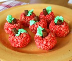 Rice krispie treat apples with a tootsie roll stem from Gourmet Mom on the Go
