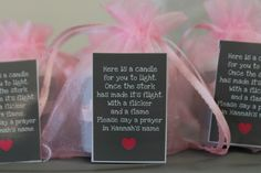 Baby shower party favor: candle with a card to light the candle and pray for the new family, new mommy, and/or baby.