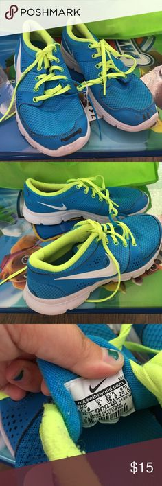 blue and green nike sneakers running sneakers. athletic shoes. neon green. electric green. blue sneakers. has two scuffs. one on each toe of the shoe. has some wear inside the shoe. Nike Shoes Sneakers