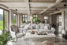 The gray, mixed in with the country chic French inspiration, executes an interior that's reminiscent of a beautiful, dreary day on the countryside. Country House Interior, Interior Design Living Room, Living Room Designs, Interior Decorating, Design Interior, Open House Plans, Log Homes, Beautiful Interiors, Home Living Room