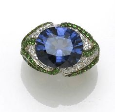 A color change spinel, diamond and tsavorite garnet ring