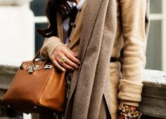camel sweater, chunky bracelet, good bag...