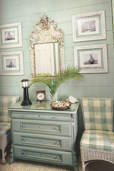 Great pieces for a coastal home!  The floating artwork really adds a clean and fresh touch!  Pale aqua board walls, painted dresser, mat around prints, and aqua and white buffalo check fabric on wicker slipper chairs