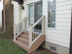 Azek wide #deck steps with Deckorators black aluminum balusters and tan railing.