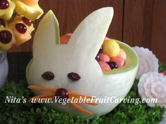 Easy magical fruit centerpiece filled with melon balls. Don't forget the raisin eyes and nose, and carrot slivers whiskers!
