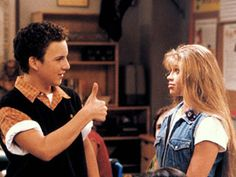 Boy Meets World//Cory knows. Note the  triple layers--white underneath, black vest, and a very cool orange in the middle. This is why he is able to give Topanga the thumbs up.