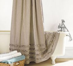 want to do the small ruffle in ticking on the bottom of drop cloth curtains.  Ticking Stripe Ruffled Shower Curtain | Pottery Barn