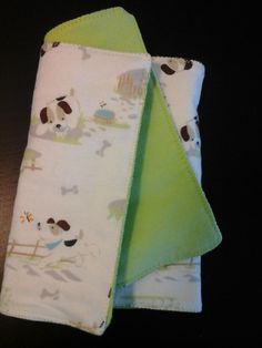 Doggone Fleece Burp Cloth...is ready for anything thrown at it. It is a doubled-sided with dog and bone on one side, and lime green on the other side, burp Cloth. It is lined with Soft and Warm Insert which makes it absorbent. To protect the burper's clothes and baby's soft skin, it measures 8 x 18 inches. See this burp cloth and others at the store of Always LOYSE