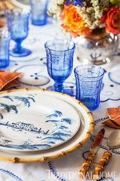 "Juliska's ""Country Estate"" dinnerware in Delft Blue on ""Classic Bamboo"" serving plates are accompanied by hand-pressed ""Delft Blue"" glasses, and ""Bamboo"" flatware. - Photo: John Bessler and Jonathan Wallen"