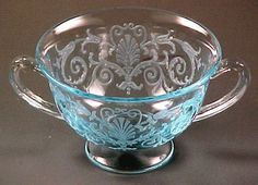 Versailles etched azure blue footed bouillon cup from Fostoria Glass. Fostoria made Versailles from 1928 to 1944 and the design is a classic. The center medallion looks like a fan surrounded by scrolls and swags.