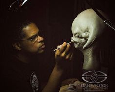 Trained as a traditional sculptor, here John Mahoney applies texture and detail to a concept creature made from WED clay.
