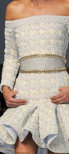 Balmain Spring 2014. White hounds tooth off the shoulder, short, ruffle skirt, long sleeve dress